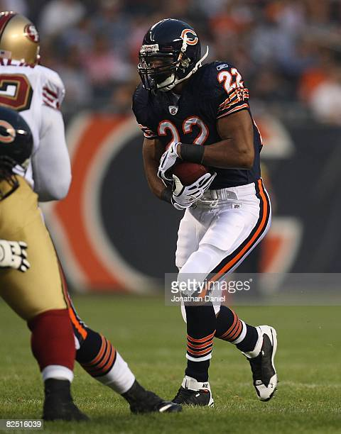 Matt Forte of the Chicago Bears looks for running room against the San Francisco 49ers on August 21 2008 at Soldier Field in Chicago Illinois The...