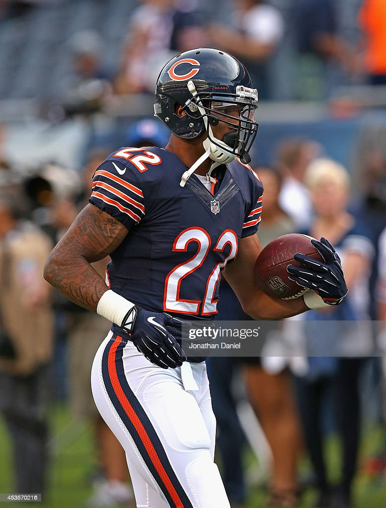 Matt Forte #22 of the Chicago Bears participates in warm-ups before a preseason game against the Philadelphia Eagles at Soldier Field on August 8, 2014 in Chicago, Illinois. The Bears defeated the Eagles 34-28.