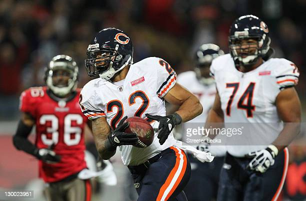 Matt Forte of the Chicago Bears scores a touchdown during the NFL International Series match between Chicago Bears and Tampa Bay Buccaneers at...