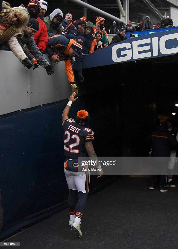 Matt Forte #22 of the Chicago Bears shakes hands with the fans after the game against the Detroit Lions on January 3, 2016 at Soldier Field in Chicago, Illinois. The Lions won 24-20.