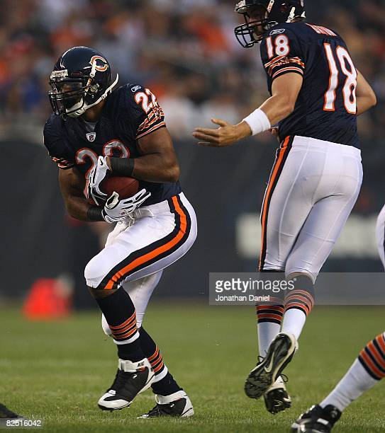 Matt Forte of the Chicago Bears takes the handoff from Kyle Orton against the San Francisco 49ers on August 21 2008 at Soldier Field in Chicago...