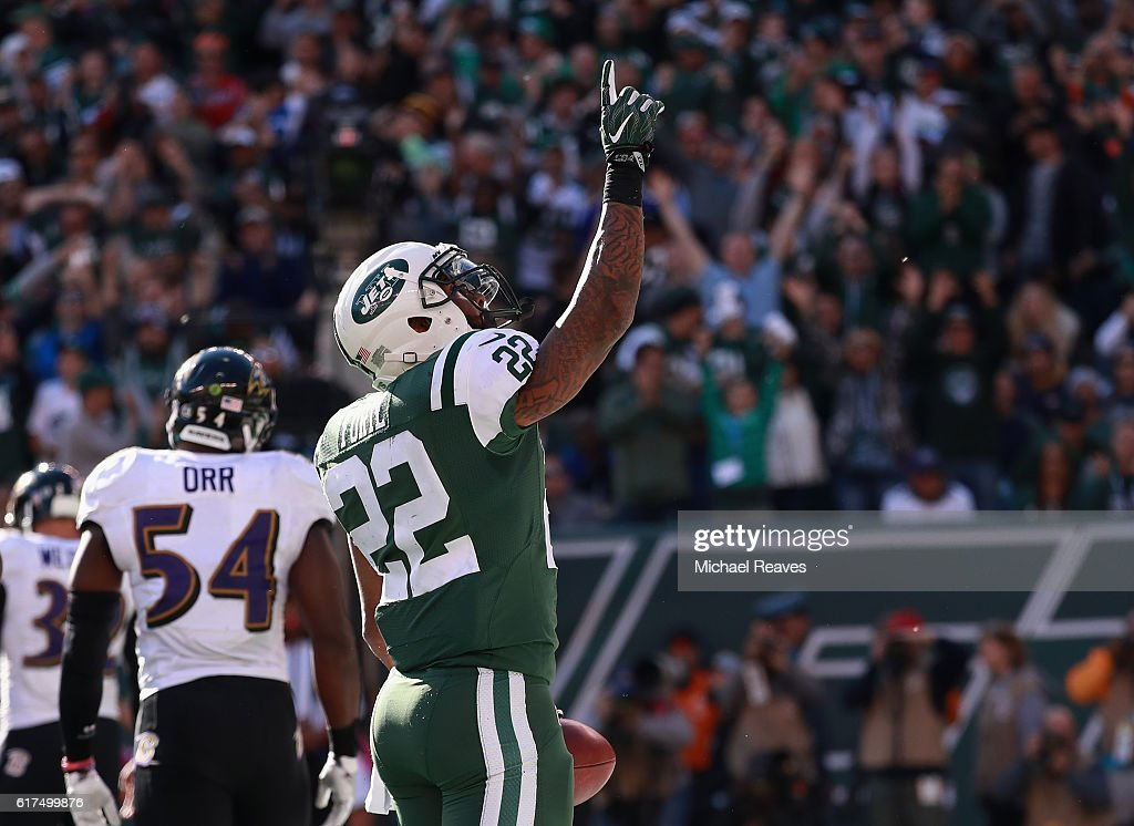 Matt Forte #22 of the New York Jets celebrates his third quarter touchdown against the Baltimore Ravens at MetLife Stadium on October 23, 2016 in East Rutherford, New Jersey.