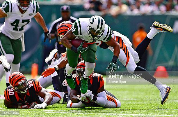 Matt Forte of the New York Jets is tackled by George Iloka of the Cincinnati Bengals during the first quarter at MetLife Stadium on September 11 2016...