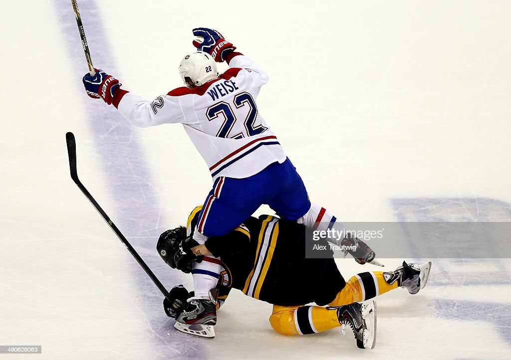 Matt Fraser #25 of the Boston Bruins gets tangled up with Dale Weise #22 of the Montreal Canadiens during Game Seven of the Second Round of the 2014 NHL Stanley Cup Playoffs at the TD Garden on May 14, 2014 in Boston, Massachusetts.