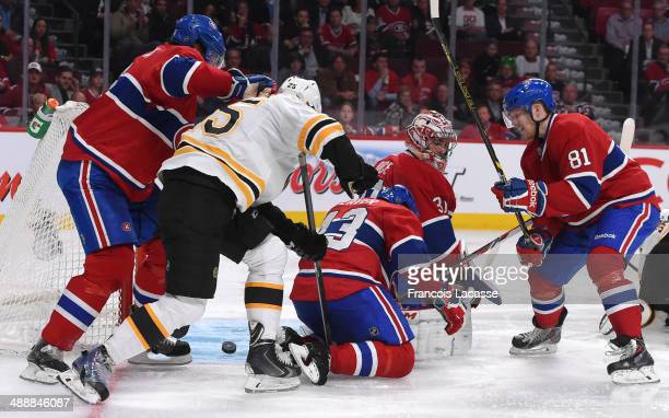Matt Fraser of the Boston Bruins scores the winning goal on goalie Carey Price while being challenged by Douglas Murray, Mike Weaver and Lars Eller...
