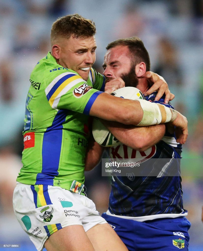 Matt Frawley of the Bulldogs is tackled by Clay Priest of the Raiders during the round nine NRL match between the Canterbury Bulldogs and the Canberra Raiders at ANZ Stadium on April 29, 2017 in Sydney, Australia.