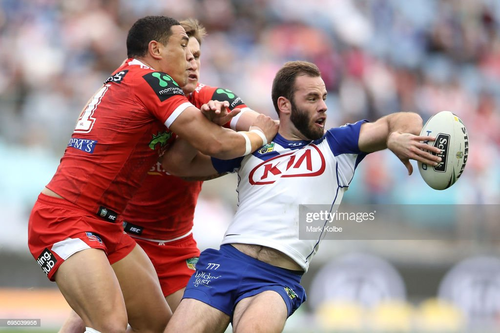 Matt Frawley of the Bulldogs passes as he is tackled during the round 14 NRL match between the Canterbury Bulldogs and the St George Illawarra Dragons at ANZ Stadium on June 12, 2017 in Sydney, Australia.