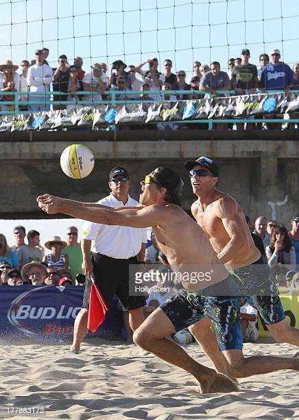 Matt Fuerbringer digs the ball while partner Casey Jennings watches during their men's finals game at the AVP Manhattan Beach Open on August 25 2013...