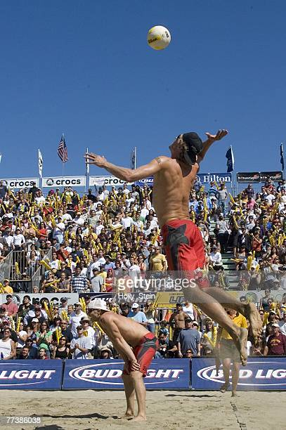 Matt Fuerbringer serves while partner Casey Jennings watches during the men's finals against Jake Gibb and Sean Rosenthal in the AVP San Francisco...