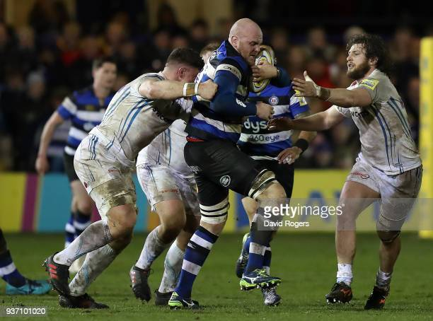 Matt Garvey of Bath is tackled by Dave Ewers and Alec Hepburn of Exeter Chiefs during the Aviva Premiership match between Bath Rugby and Exeter...