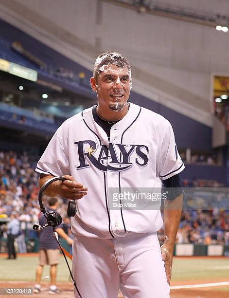 Matt Garza Evan Longoria of the Tampa Bay Rays looks on after he received a shaving cream pie to the face from teammate Evan Longoria in celebration...