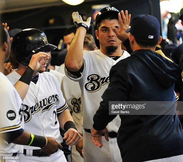 Matt Garza is greeted after scoring against the Cincinnati Reds during the fourth inning of the Milwaukee Brewers on September 14 2014 at Miller Park...