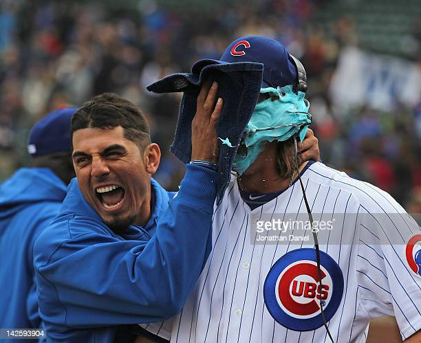 Matt Garza of the Chicago Cubs smears shaving cream into the face of pitcher Jeff Samardzija after a win against the Washington Nationals at Wrigley...