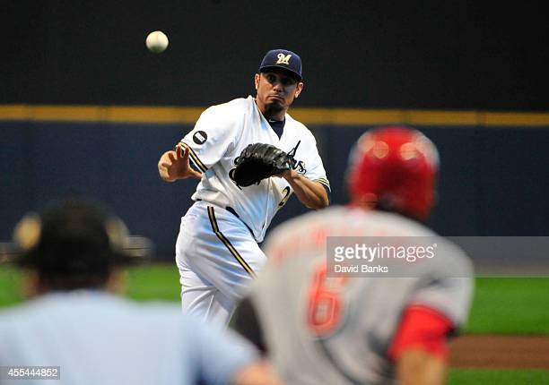 Matt Garza of the Milwaukee Brewers can't field a single hit by Billy Hamilton of the Cincinnati Reds during the first inning on September 14 2014 at...