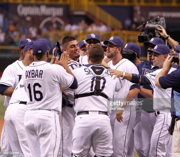 Matt Garza of the Tampa Bay Rays is surrounded by his teammates in celebration of Garza pitching a nohitter in the Rays' 50 win against the Detroit...