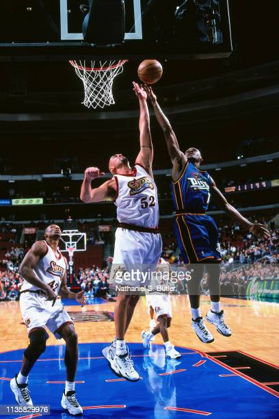 Matt Geiger of Philadelphia 76ers goes up for a shot against Lindsey Hunter of the Detroit Pistons on February 9 1999 at the First Union Center in...