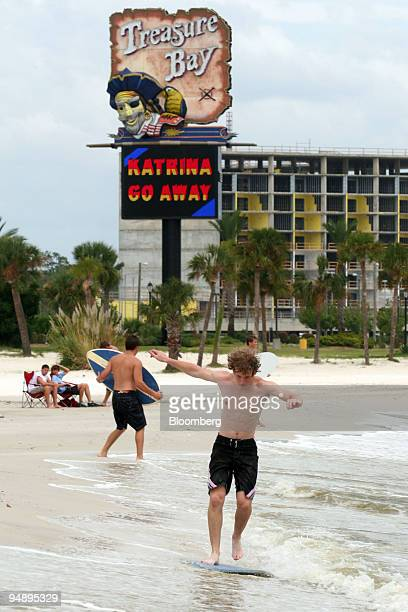 Matt Geiser rides a skim board in front of the Treasure Bay Casino in Biloxi Mississippi Sunday August 28 2005 as Hurricane Katrina approaches the...