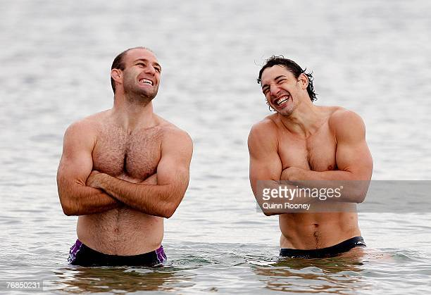 Matt Geyer and Billy Slater of the Storm share a laugh during a Melbourne Storm recovery session held at St Kilda beach on September 19 2007 in...