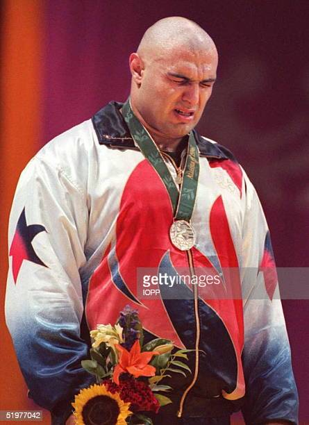 Matt Ghaffari of the US sobs on the podium after losing to Russian Alexander Karelin in the Olympic super heavyweight GrecoRoman wrestling final 23...