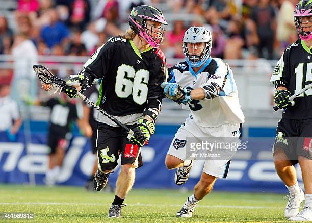Matt Gibson of the New York Lizards in action against Jake Bernhardt of the Ohio Machine during their Major League Lacrosse game at Shuart Stadium on...