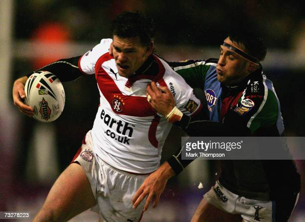 Matt Gidley of St Helens is tackled by Rob Purdham of Harlequins during the Engage Super League match between St Helens and Harlequins at the Mosley...