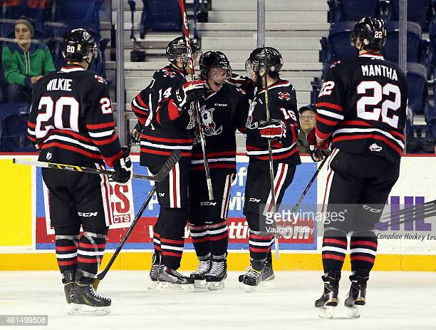 Matt Gillard of the Niagara IceDogs celebrates a goal with teammates during an OHL game against the Mississauga Steelheads at the Meridian Centre on...