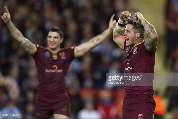 Matt Gillett and Corey Parker of the Maroons celebrate victory during game two of the State Of Origin series between the Queensland Maroons and the...