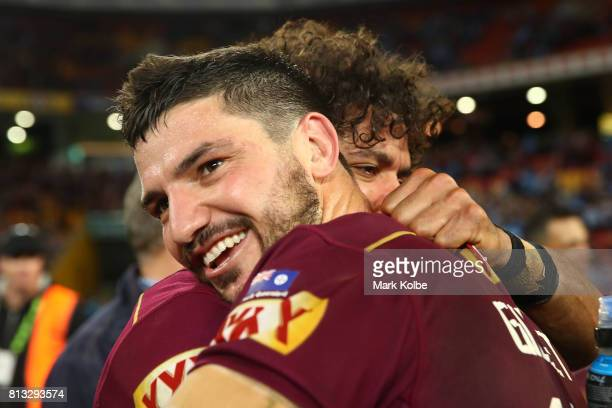 Matt Gillett and Dane Gagai of the Maroons celebrate after winning game three of the State Of Origin series between the Queensland Maroons and the...