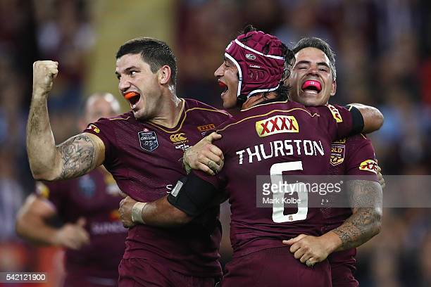 Matt Gillett Johnathan Thurston and Corey Parker of the Maroons celebrate victory during game two of the State Of Origin series between the...