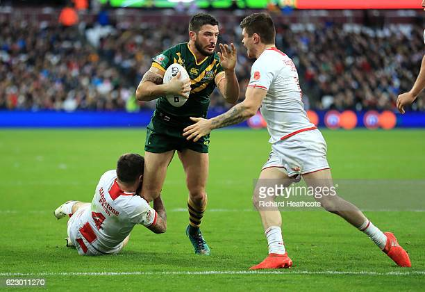 Matt Gillett of Australia goes over to score a try during the Four Nations match between the England and Australian Kangaroos at Olympic Stadium on...