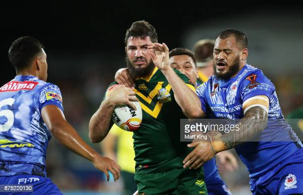 Matt Gillett of Australia is tackled during the 2017 Rugby League World Cup Quarter Final match between Australia and Samoa at Darwin Stadium on...