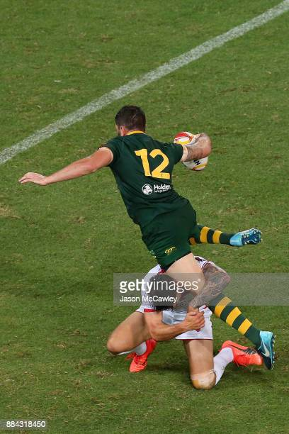 Matt Gillett of Australia is tackled during the 2017 Rugby League World Cup Final between the Australian Kangaroos and England at Suncorp Stadium on...
