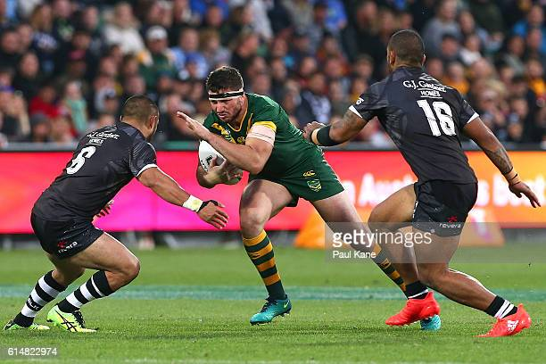 Matt Gillett of Australia runs the ball before being tackled by Thomas Leuluai of New Zealand during the International Rugby League Test match...