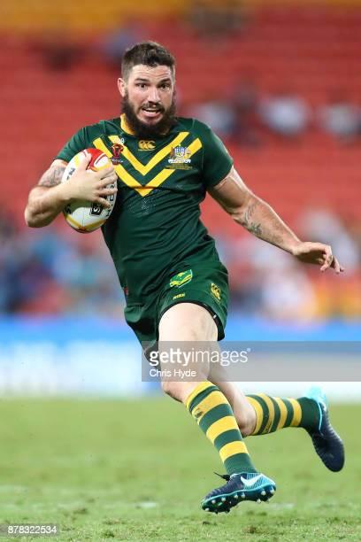 Matt Gillett of Australia runs the ball during the 2017 Rugby League World Cup Semi Final match between the Australian Kangaroos and Fiji at Suncorp...