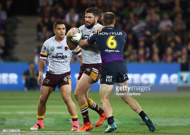 Matt Gillett of the Brisbane Broncos is challenged by Cameron Munster of the Storm during the NRL Preliminary Final match between the Melbourne Storm...