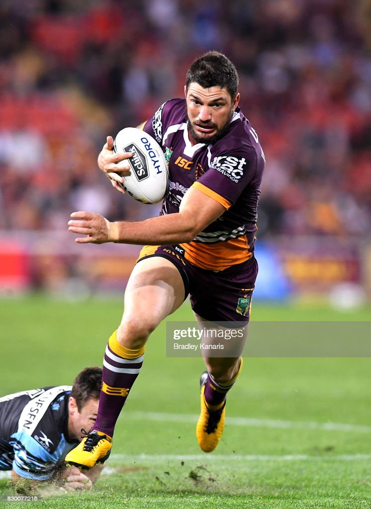 Matt Gillett of the Broncos breaks away from the defence during the round 23 NRL match between the Brisbane Broncos and the Cronulla Sharks at Suncorp Stadium on August 11, 2017 in Brisbane, Australia.