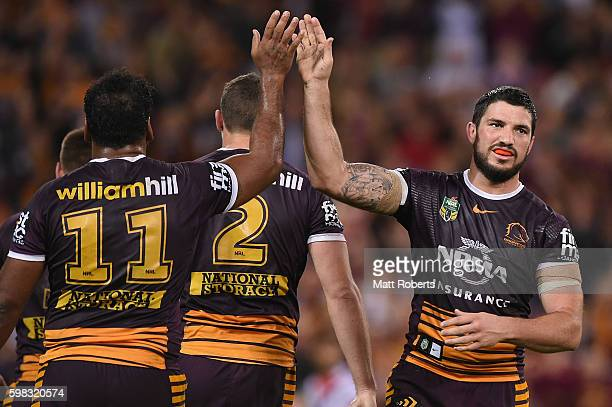 Matt Gillett of the Broncos celebrates with team mates during the round 26 NRL match between the Brisbane Broncos and the Sydney Roosters at Suncorp...