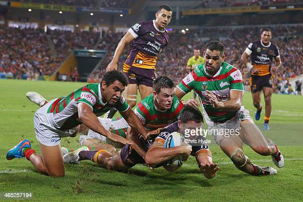 Matt Gillett of the Broncos dives to score a try during the round one NRL match between the Brisbane Broncos and the South Sydney Rabbitohs at...