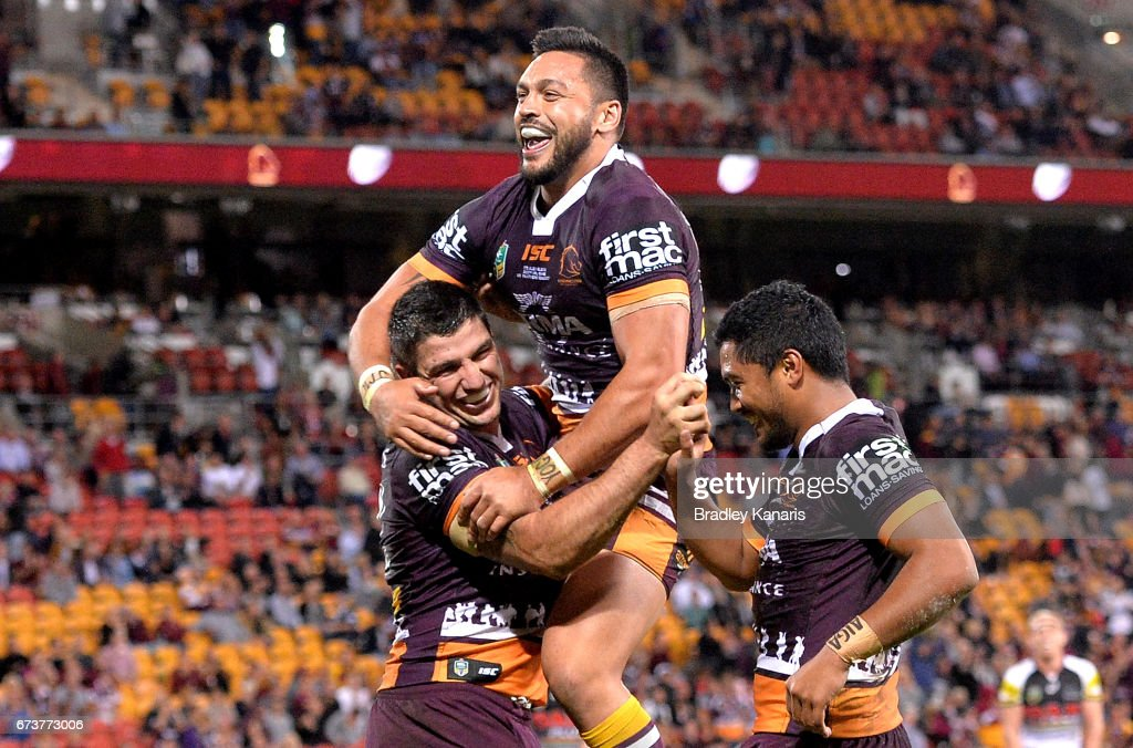 Matt Gillett of the Broncos is congratulated by team mates after scoring a try during the round nine NRL match between the Brisbane Broncos and the Penrith Panthers at Suncorp Stadium on April 27, 2017 in Brisbane, Australia.