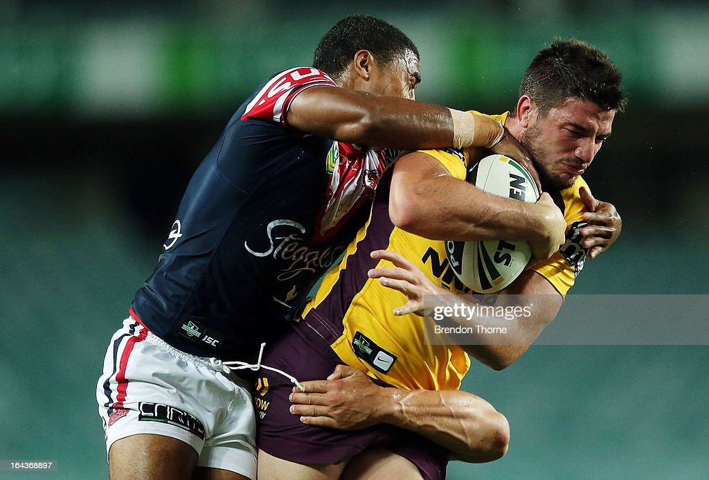 Matt Gillett of the Broncos is tackled by the Roosters defence during the round three NRL match between the Sydney Roosters and the Brisbane Broncos at Allianz Stadium on March 23, 2013 in Sydney, Australia.