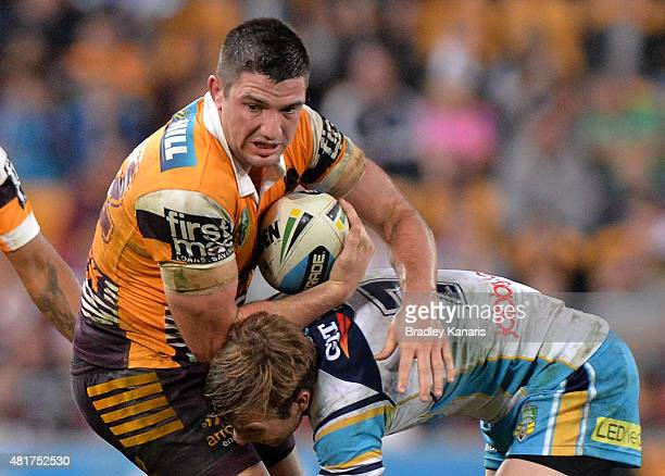 Matt Gillett of the Broncos is tackled during the round 20 NRL match between the Brisbane Broncos and the Gold Coast Titans at Suncorp Stadium on...