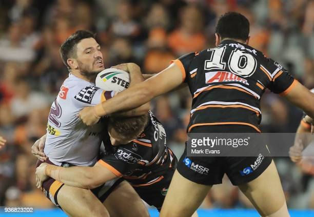 Matt Gillett of the Broncos is tackled the round three NRL match between the Wests Tigers and the Brisbane Broncos at Campbelltown Sports Stadium on...