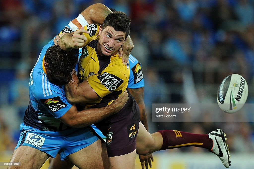 Matt Gillett of the Broncos offloads in the tackle during the round five NRL match between the Gold Coast Titans and the Brisbane Broncos at Skilled Park on April 5, 2013 on the Gold Coast, Australia.