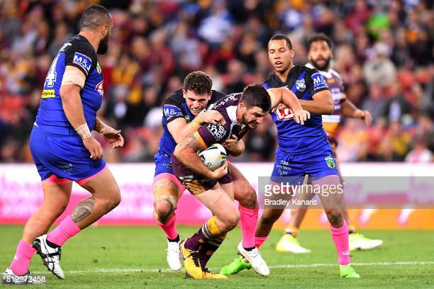 Matt Gillett of the Broncos takes on the defence during the round 20 NRL match between the Brisbane Broncos and the Canterbury Bulldogs at Suncorp...