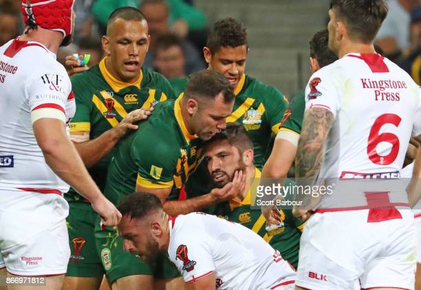 Matt Gillett of the Kangaroos is congratulated by Cameron Smith and his teammates after scoring a try during the 2017 Rugby League World Cup match...