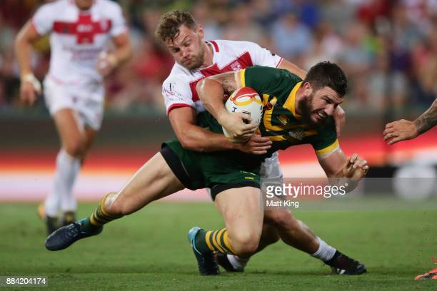 Matt Gillett of the Kangaroos is tackled during the 2017 Rugby League World Cup Final between the Australian Kangaroos and England at Suncorp Stadium...