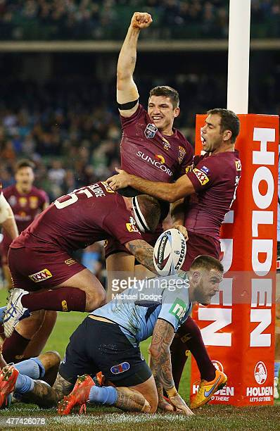 Matt Gillett of the Maroons celebrates scoring a try with Cameron Smith during game two of the State of Origin series between the New South Wales...