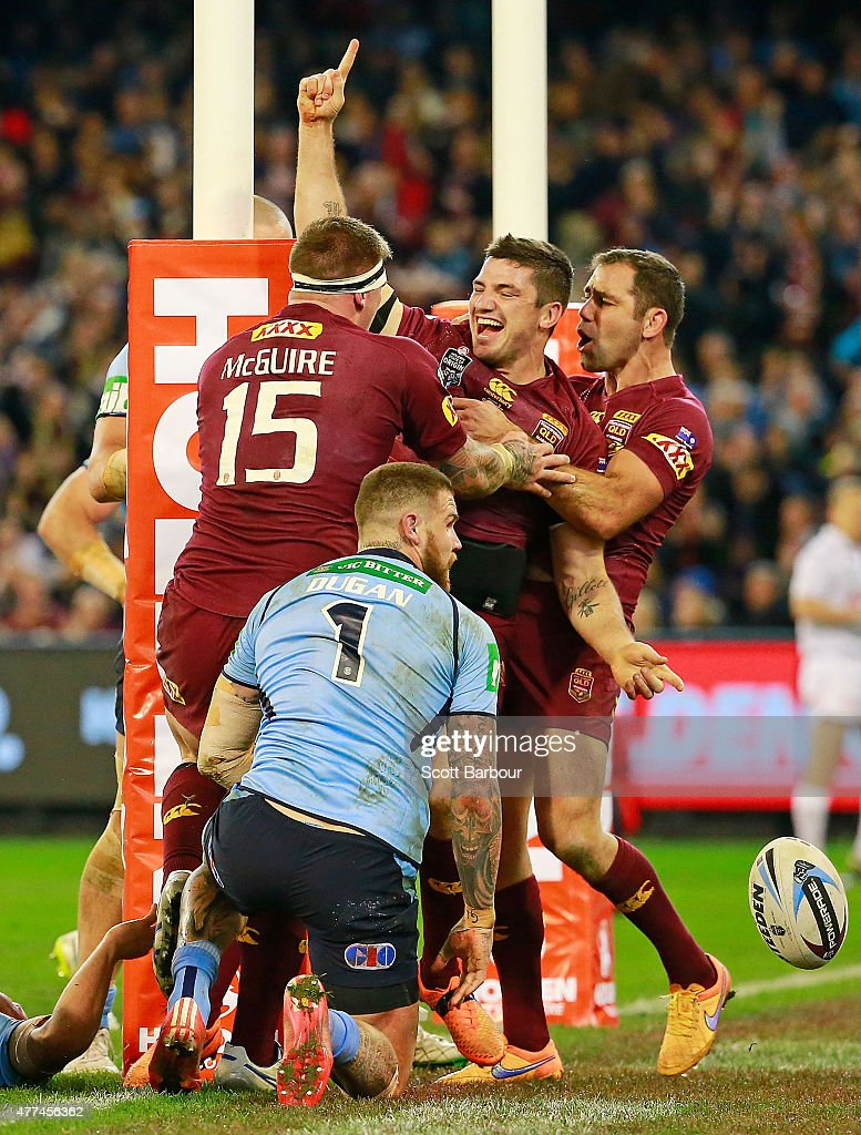 Matt Gillett of the Maroons celebrates scoring a try with Cameron Smith (R) during game two of the State of Origin series between the New South Wales Blues and the Queensland Maroons at the Melbourne Cricket Ground on June 17, 2015 in Melbourne, Australia.