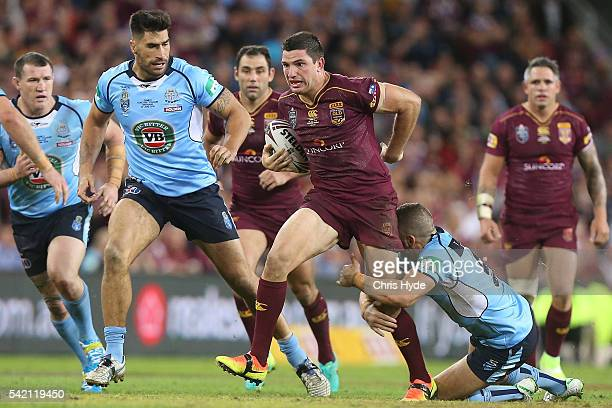 Matt Gillett of the Maroons runs the ball during game two of the State Of Origin series between the Queensland Maroons and the New South Wales Blues...