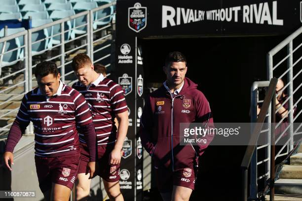 Matt Gillett walks out from the sheds after being ruled out of game three during a Queensland Maroons State of Origin Captain's Run at ANZ Stadium on...